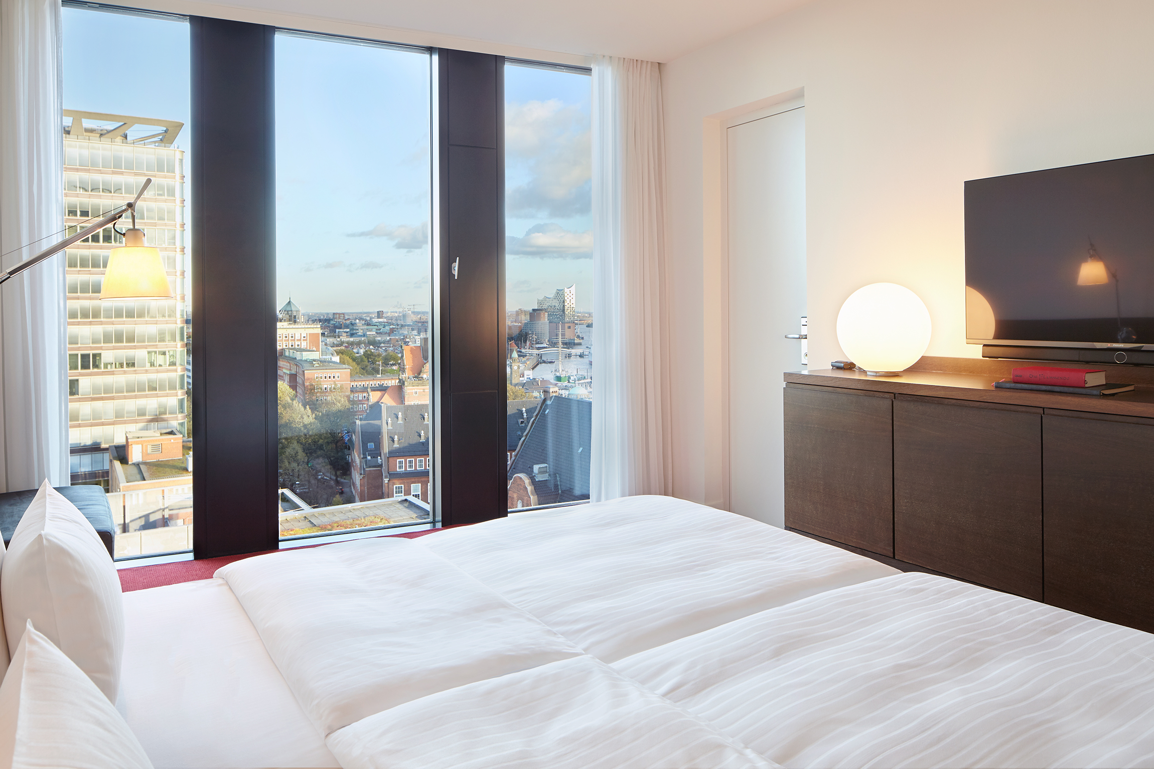 Bed with a View | Deluxe | Empire Riverside Hotel